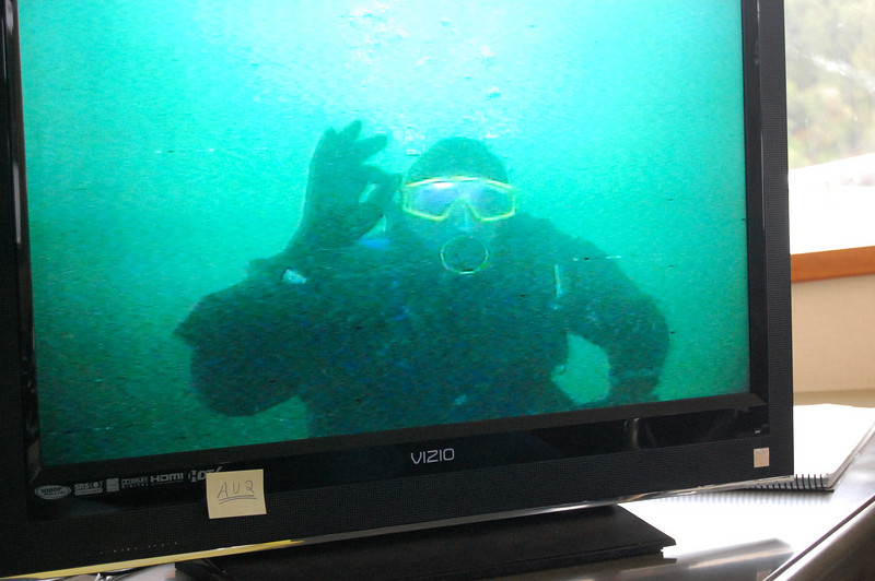 Bill Anders gives the OK sign underwater