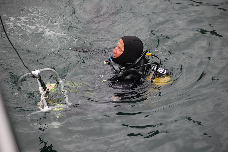 Joe passing up the video camera at the end of the dive.