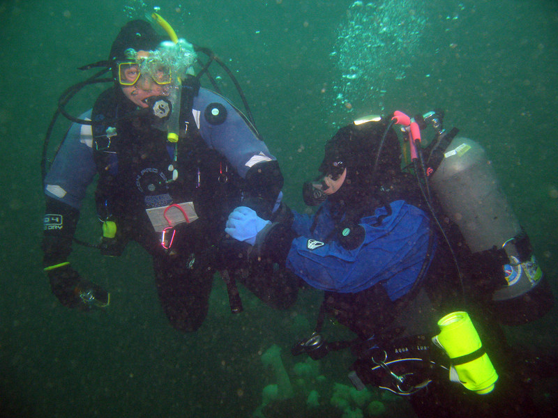 Laura hanging onto Claude when she discovered the source of her off-kilter buoyancy - a missing weight pocket!! (10 pounds).