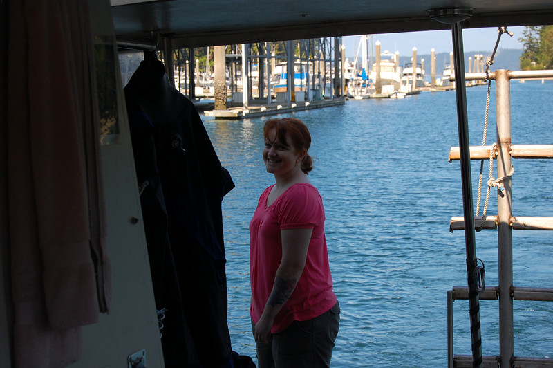 Krista on the stern, waiting to help dock the boat.