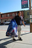 "Aquarium employee with sack of ""bycatch"" walks by on Cannery Row..."
