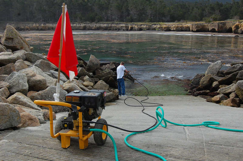 Keith Rootsaert power washes the slippery Point Lobos boat ramp so it's safe for divers. Very very low tide the day we were there.