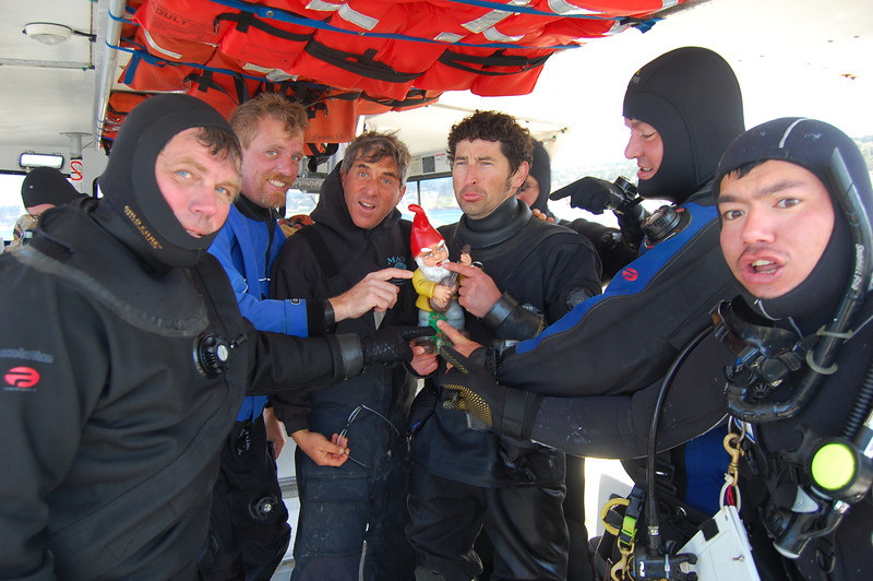 Show me on the gnome where the bad Captain touched you.....(Gregg Cline, Keith Rootsaert, Captain Phil Sammet, Pete Naylor, Steve Lonhart, Alex Matsumoto) As Capt. Phil was helping divers gear up, he would ask permission to touch them (jokingly of course). That morphed into THIS. Notice it's all boys here....hmmm.