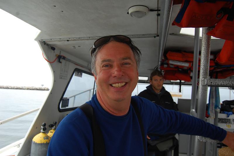 Sunny smiling John Wolfe