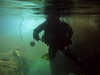 Claude drifts inside a sea cave.