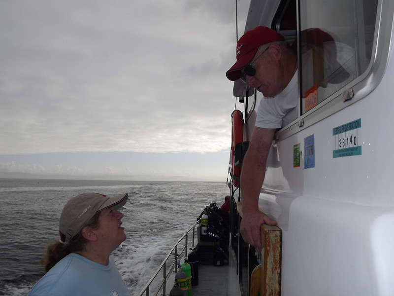 One of many consults with Captain Phil about conditions, site location, weather, etc. Photo by Todd Cliff