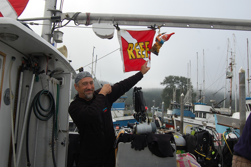 Randy shows off his handiwork of hanging up the REEF flag and the gnome