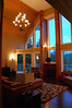 Vaulted ceiling in living room with beautiful view of harbor