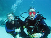 Happy surveyors underwater.