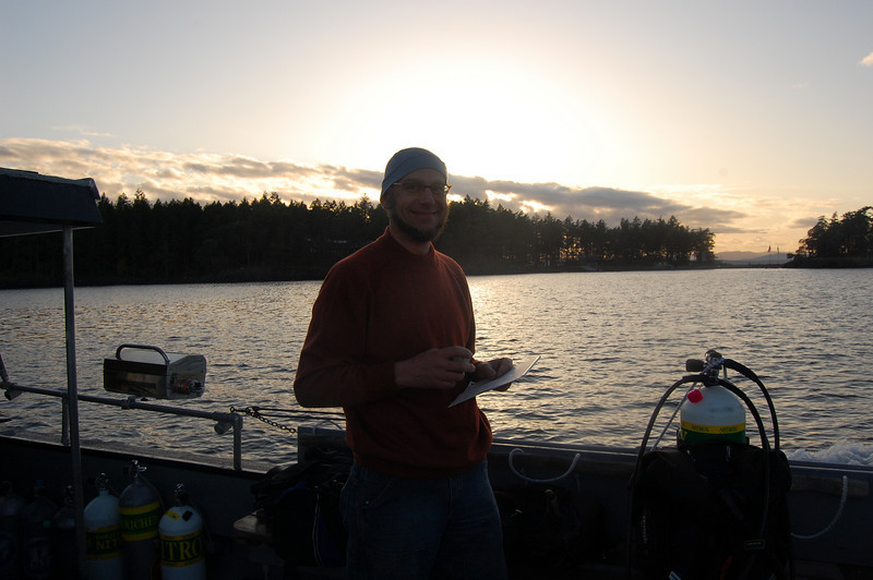 Greg with sunset behind him, heading back to Friday Harbor.