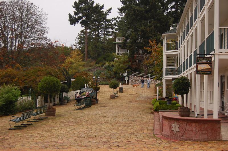Brick walkway in front of hotel