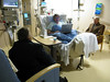 Hanging out before surgery, visiting with his parents