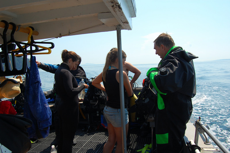 Gearing up. Alicia, our deckhand assists.