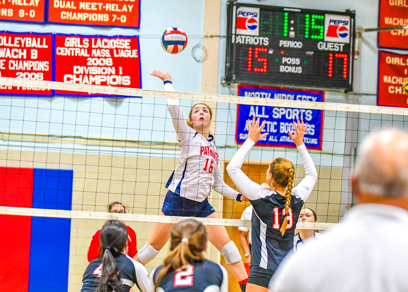 North MIddlesex middle hitter Madeline Harrington sizes up a spike at the net during Thursday's loss to Wellesley. Nashoba Valley Voice/Ed Niser