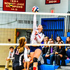 North Middlesex's Sarah Kleeman spikes the ball during Thursday night's loss to Wellesley.<br /> Nashoba Valley Voice/Ed Niser