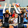 North Middlesex captain Lynn Shattuck spikes the ball between Welleseley's Catie Jones and Lindsay Canaday.<br /> Nashoba Valley Voice/Ed Niser