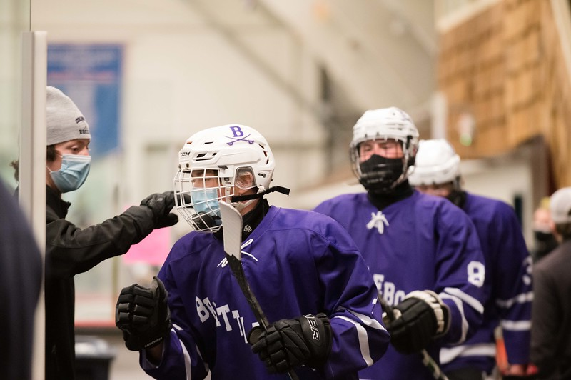 Austin Wood offers support to his team mates as they take the ice for the Divisiion-2 championship game against Harwood Wednesday, 3/24.