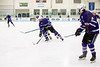 Sam Hall brings the puck down the ice for the Colonels during Wednesday's D-2 championship game against Harwood in Barre.