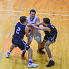 Groton-Dunstable senior guard Tyler Leclerc (center) battles for the ball with Medway's Nicholas Assad and Christos Brooks. Nashoba Valley Voice/Ed Niser