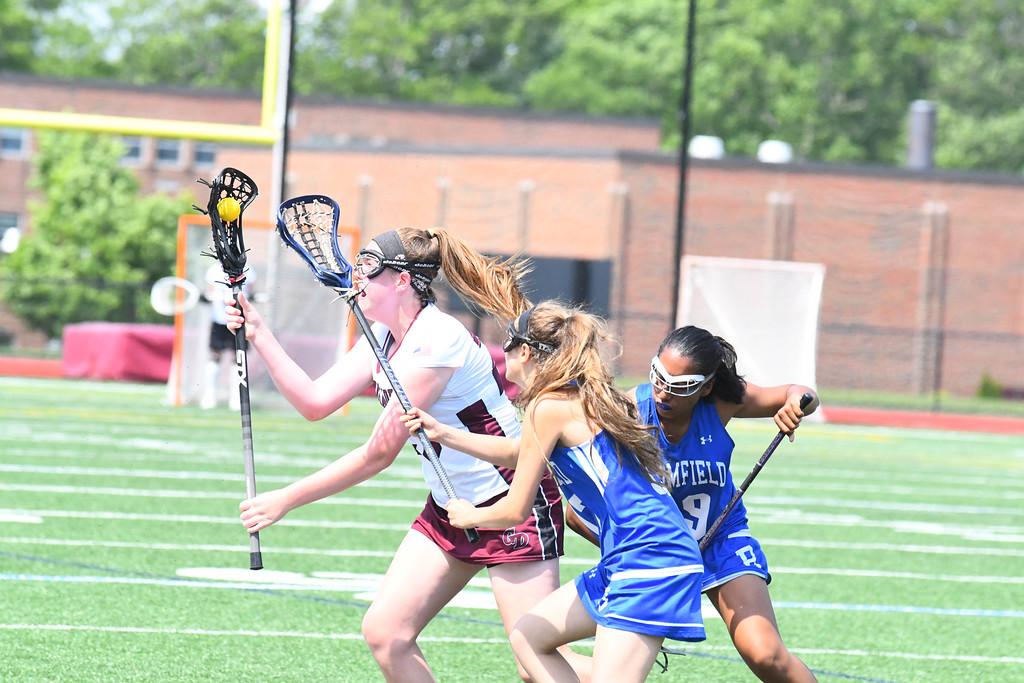 . Groton-Dunstable\'s Abigail Hoey runs with the ball. Sun/Ed Niser