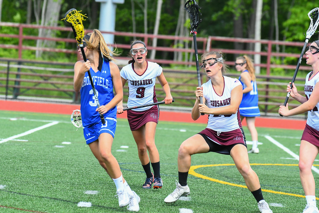 . Bromfield\'s Isabelle Planchet is swarmed by Groton-Dunstable defenders Sammi Smith and Jordan Wynn. Sun/Ed Niser