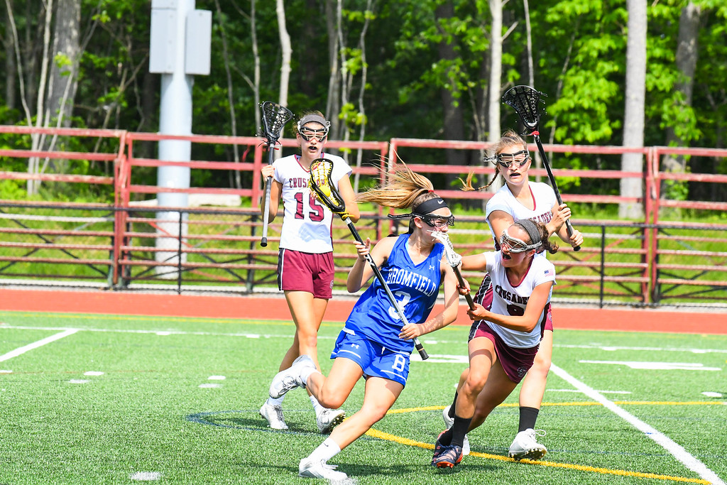 . Groton-Dunstable \'s Sammi Smith defends Bromfield\'s Isabelle Planchet. Sun/Ed Niser
