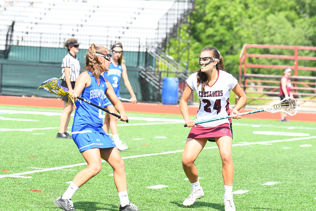 . Groton-Dunstable\'s Julia Stathis defends Bromfields Meaghan Parlee. Sun/Ed Niser