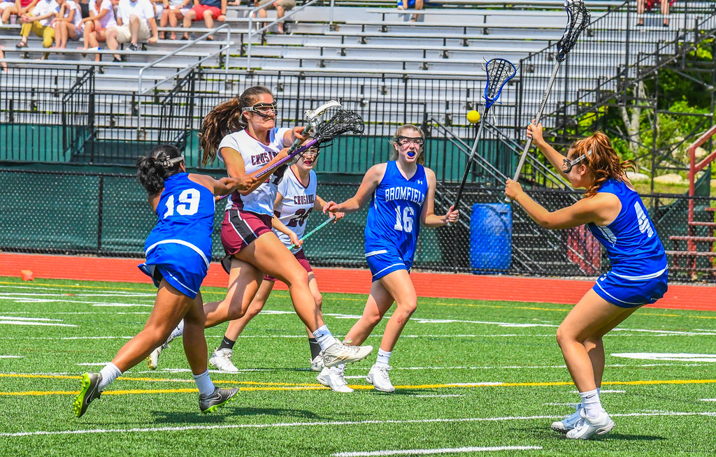. Groton-Dunstable\'s Julia Stathis shoots as she is defended by Bromfield\'s Raiya Suliman, left, and Anita Childers. Sun/Ed Niser
