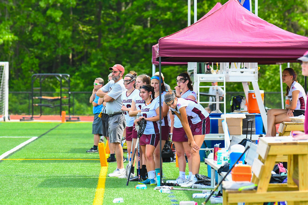 . The Groton-Dunstable bench looks on during Saturday\'s Division 2 Central/Western Mass championship. Sun/Ed Niser