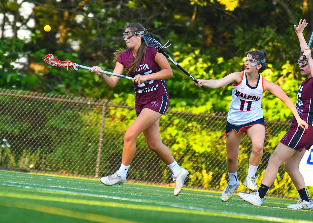 . Groton-Dunstable\'s Erin Keough tracks down a pass as she is defended by Walpole\'s Grace Harrington. Sun/Ed Niser