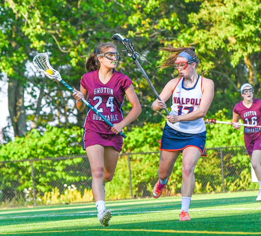 . Groton-Dunstable\'s Julia Stathis drives against Walpole\'s Meaghan Foley. Sun/Ed Niser