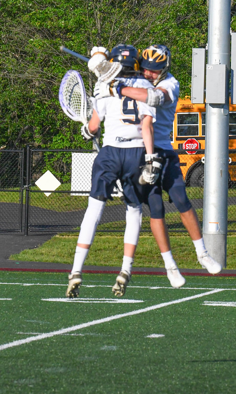 . Littleton\'s Brandon Witherall is embraced by teammate Anthony Rausa. Sun/Ed Niser