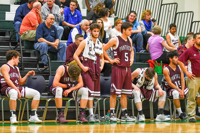 Ayer Shirley seniors, from far  left, Jeff Gendron, Alex Patano, Jarrod Oberg, Noah Watson and Ben Hebert reflect on their final minutes of their high school basketball careers after checking out late in the fourth quarter. Nashoba Valley Voice/Ed Niser