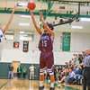 Ayer Shirley's Leo Rosales fires a three-pointer during Tuesday's game. Nashoba Valley Voice/Ed Niser