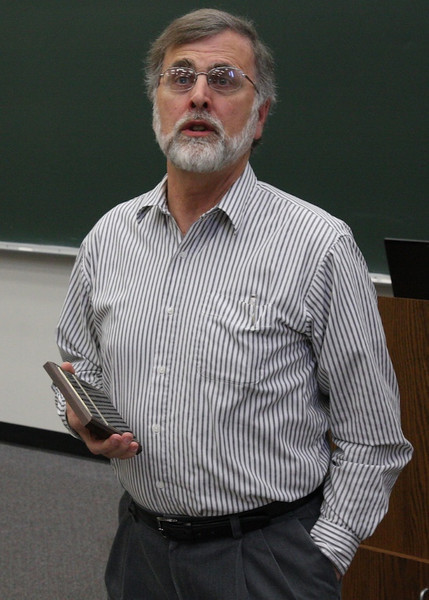 Dr. Lee Turner presenting  the Math Outstanding Freshman Award.