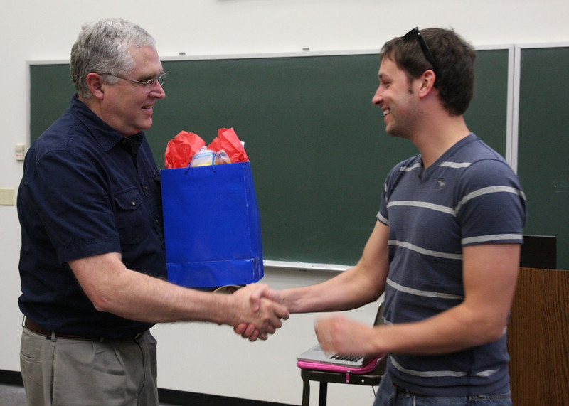 Dr. Wes Hanson presents Trae Beasler with the Biology Outstanding Senior Award.