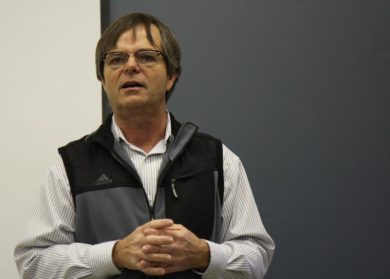 Dr. Cox emcees the program.