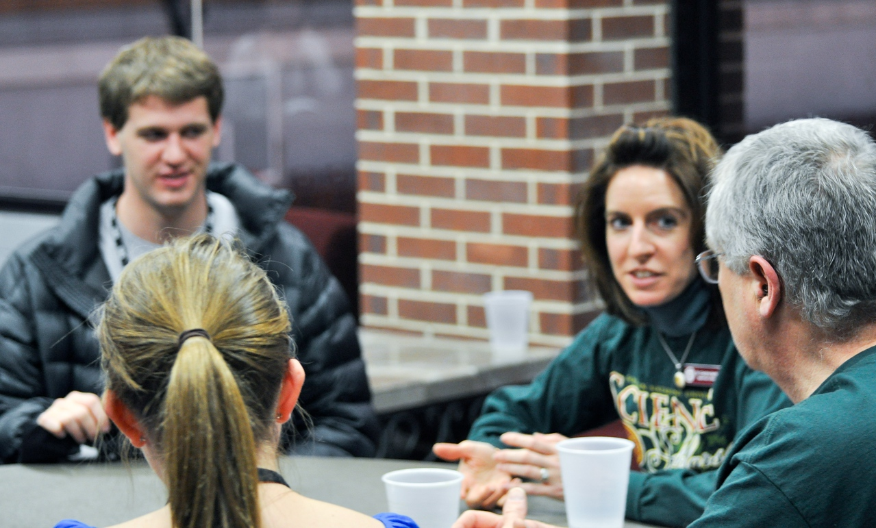 Drs. Bentley (left) and Hanson (right), Biology professors, get to know students during dinner on Friday evening.