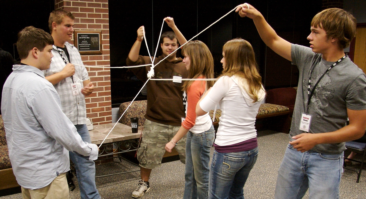 Participants and students will eventually find a way to untie this knot without letting go of their strings.