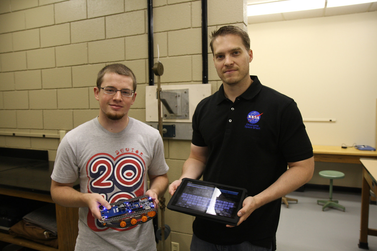 Having just finished building the robot, Dr. Brent Eskridge and Blake Jordan show off the devices used in their research. Over the course of the six weeks of summer research, the Computer Science Team is going to experiment in augmented reality to control the rover with a tablet via bluetooth.
