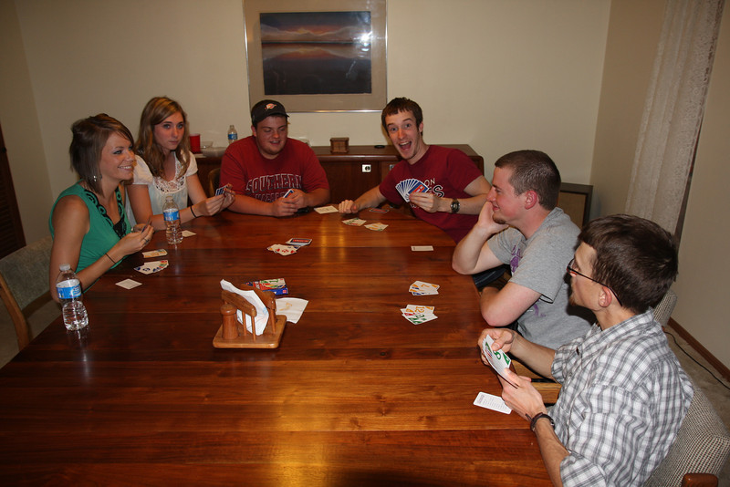 Enjoying their time outside the lab, Dr. Zoller and some of the summer researchers try their hand at Phase 10. Dr. Zoller is the mentor for the mathematics research team this summer.