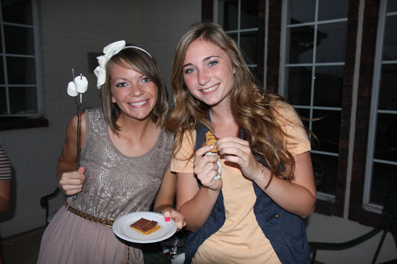 Enjoying s'mores at Dr. Winslow's house, Bre Simmons and Angela Zanotti take a break from the research and enjoy a beautiful summer night with the rest of the team.