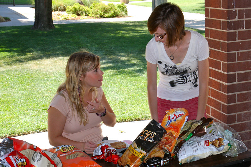 Discussing further summer plans, Mary Siems and Kaitlyn Orwig finish off their sandwiches.