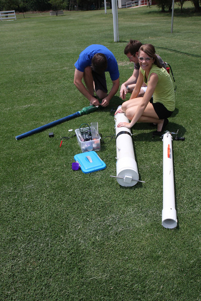 Deciding to get outside the lab for awhile, the Physics Summer Research Team takes their potato cannons to the SNU soccer field to shoot off some vegetables. Here the team is assembling the smaller of the two cannons which ended up shooting the length of the field. Dr. Winslow even managed a goal from one of the shots!