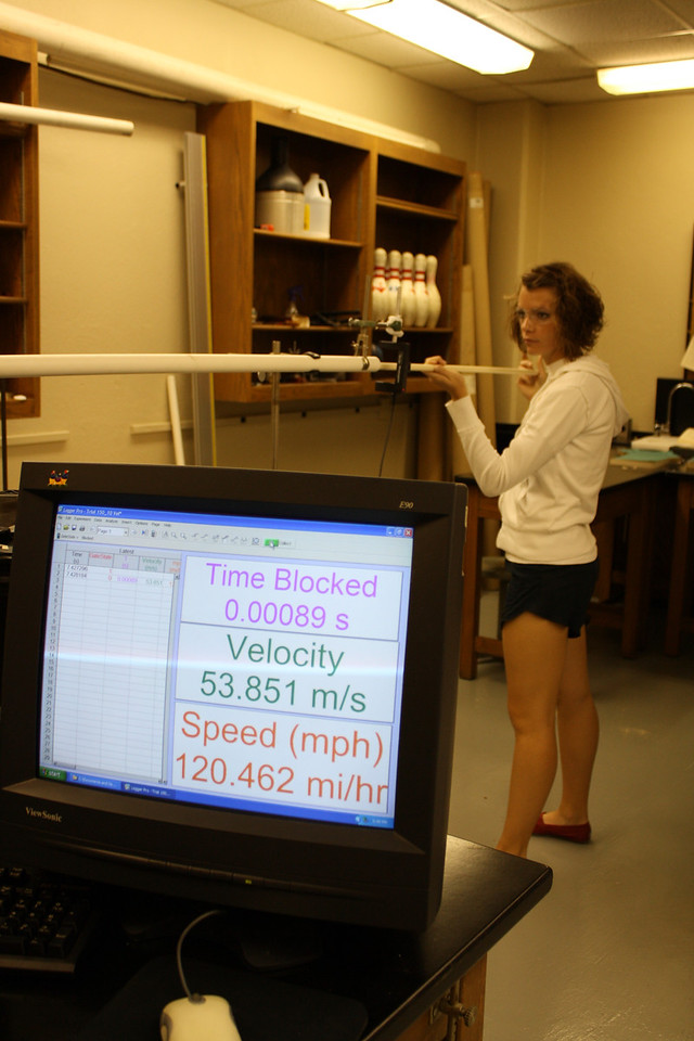 Loading the potato canon, Bre Simmons, Junior, inserts a metal cylinder (the projectile) into the PVC pipe that acts as the barrel of the cannon. Their top speed for this first day of shooting was 133 mph!