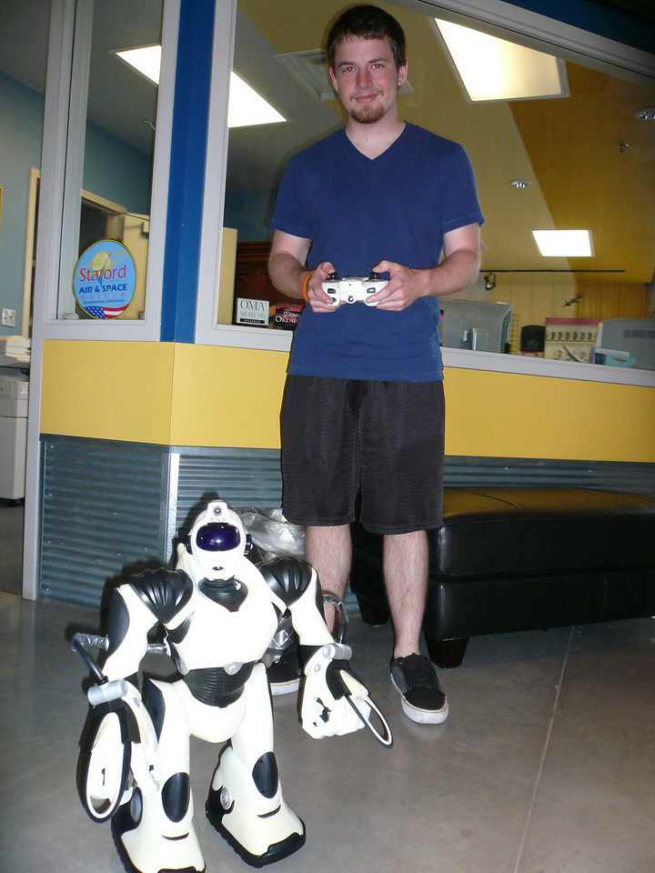 Blake and a robot.  Is he getting ready to take over the world?