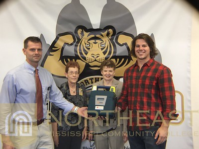 2015-11-17 FITNESS AED Donation to Burgess from Faculty Association