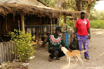 Lamin with his dog and friend