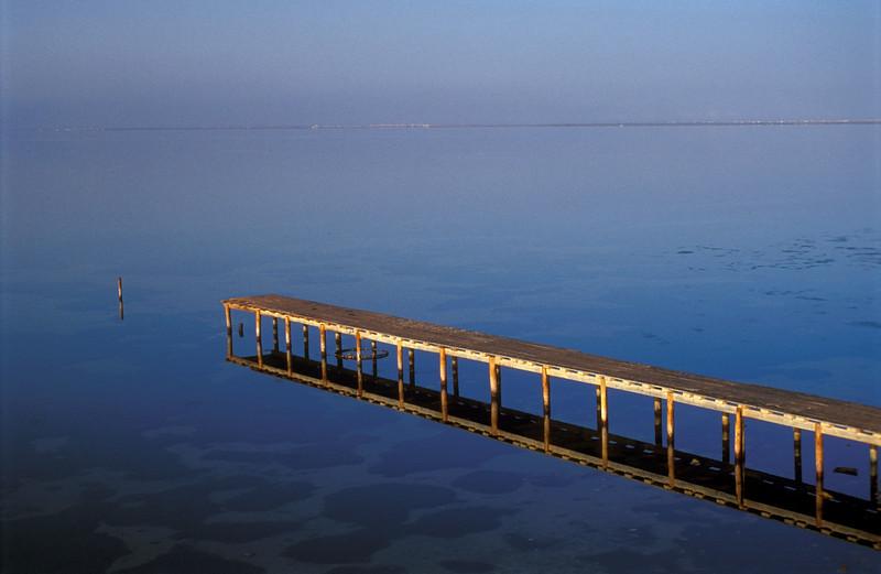Wooden Pier Reflected in Water, Djerba