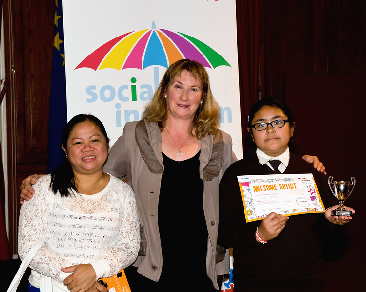 Lorna & Maria Santos (Dominican Convent) with Angela Hogan from the dlr Social Inclusion Unit.<br /> Photograph: Margaret Brown<br /> Primary Schools Drawing Competition, Prize giving Ceremony took place in the Assembly Room, County Hall at 4.30pm Wednesday 15 October 2014 as part of Social Inclusion Week 2014.